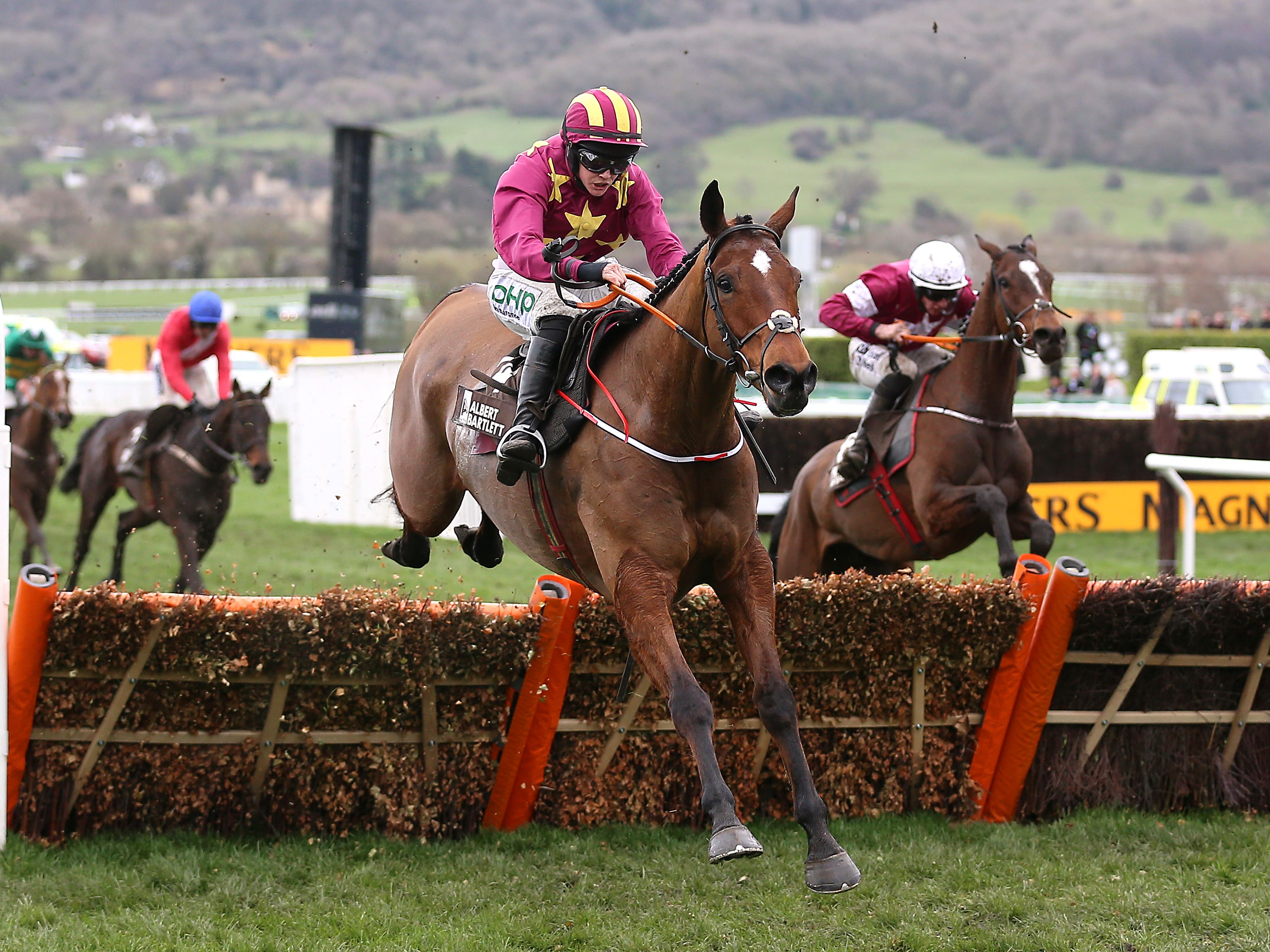 Minella Indo jumps the last clear in the Albert Bartlett (Nigel French/PA)