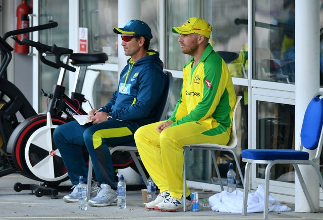 Aaron Finch, right, suggested criticism of Justin Langer, left, is a storm in a teacup (Dan Mullan/PA)