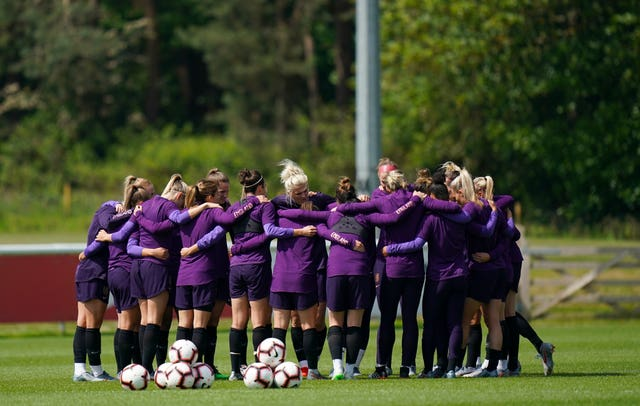 England's players in a huddle during a training session at St George's Park