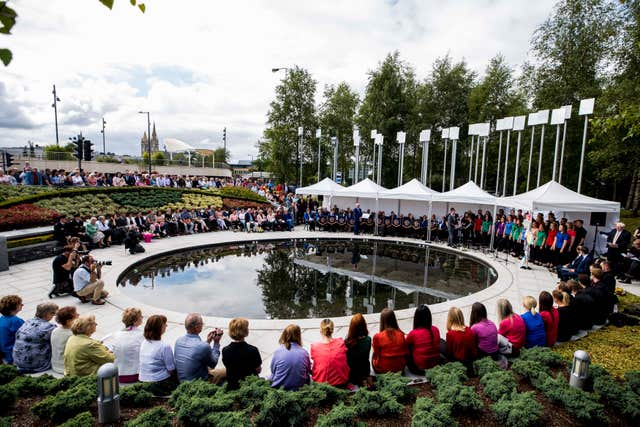 Family and relatives gather at the inter-denominational service at the Memorial Gardens in Omagh