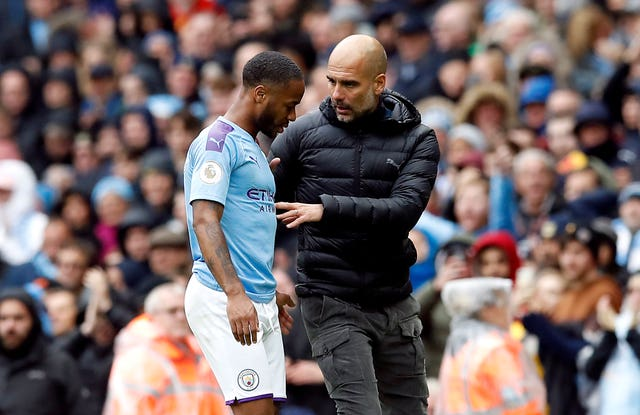 Pep Guardiola speaks to Raheem Sterling after he is substituted