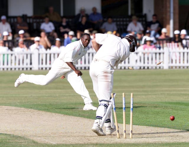Devon Malcolm in action for Leicestershire