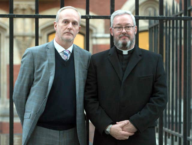 Canon Jeremy Pemberton (right) and husband Laurence Cunnington (David Mirzoeff/PA)