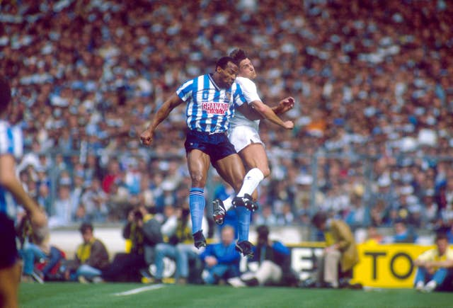Regis, pictured contesting a header with Tottenham's Gary Mabbutt, played in the 1987 FA Cup final at Wembley which saw Coventry win 3-2 after extra time