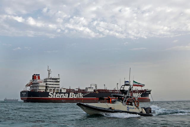 A speedboat from Iran's Revolutionary Guard moves around the British-flagged oil tanker Stena Impero