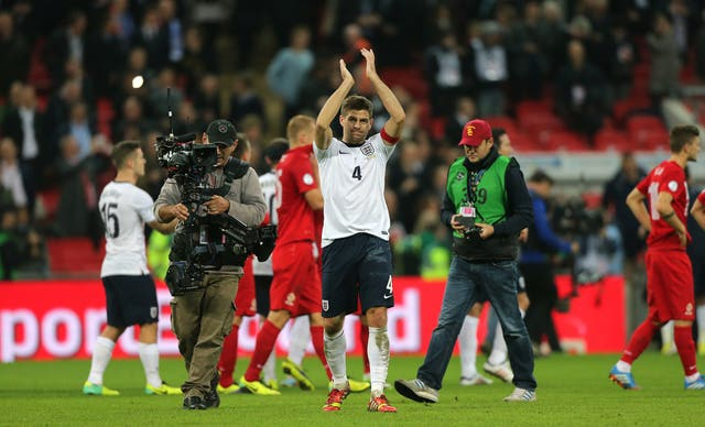 Steven Gerrard celebrates after firing England to Brazil