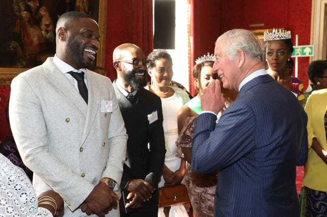 Charles with Lethal Bizzle at St James's Palace