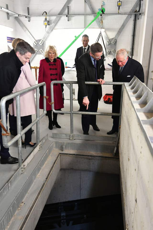 The Prince of Wales and Duchess of Cornwall inspect the shaft down to the tunnels during the opening of The National Grid's London Power Tunnels project in north London, a new electricity superhighway supplying power to the capital from deep below the streets. (John Stillwell/PA)