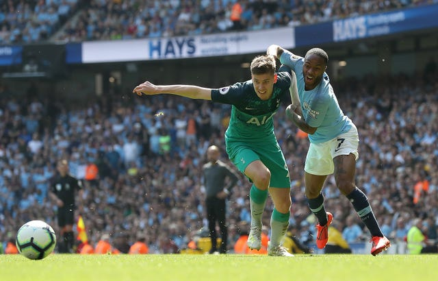 Raheem Sterling, right, tussles with Juan Foyth