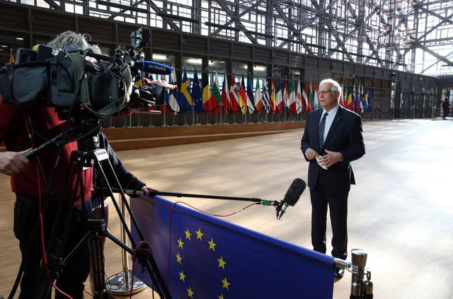 European Union foreign policy chief Josep Borrell speaks with the media as he arrives for a meeting of EU foreign ministers at the European Council building in Brussels