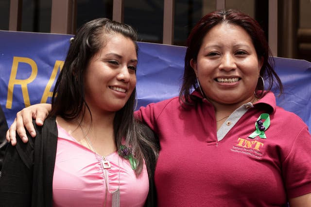Ms Hernandez, left,  stands with Teodora Vasquez, who was convicted and imprisoned for 10 years in a similar case before her sentence was eventually commuted