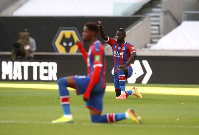 Wilfried Zaha takes a knee for Black Lives Matter prior to a Premier League game