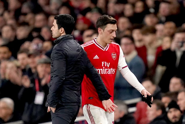 Mesut Ozil, right, has not played since March