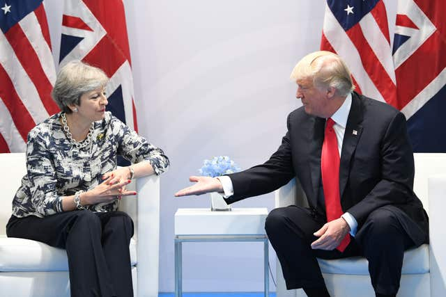 File photo dated 08/07/17 of Prime Minister Theresa May holding talks with US President Donald Trump