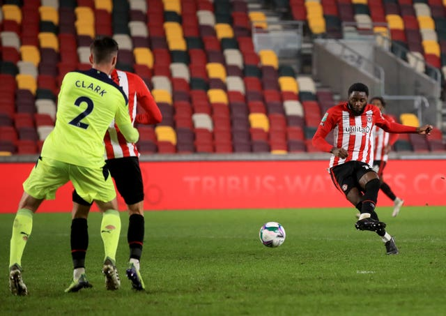 Josh Dasilva, right, scores Brentford's winner against Newcastle