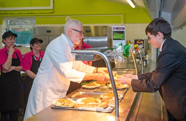 Jeremy Corbyn serves up school dinners at Bilton High School in Rugby