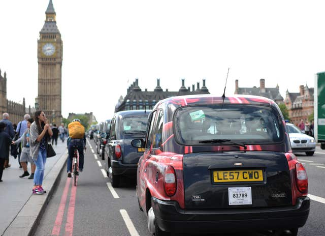 Taxi drivers on Westminster Bridge (Lauren Hurley/PA)