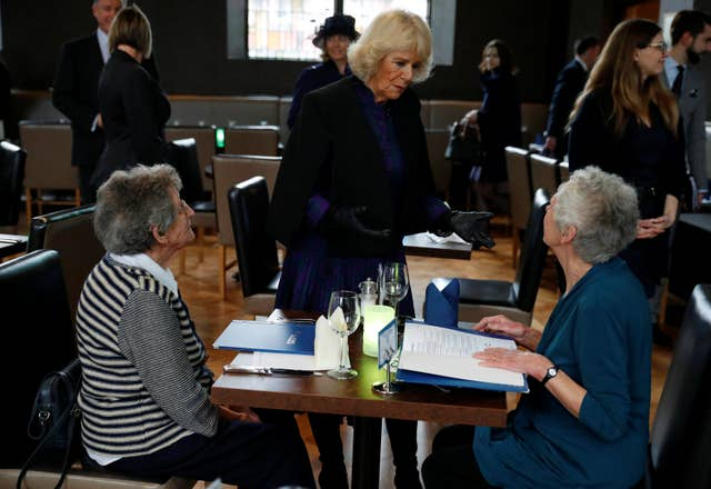 The Duchess of Cornwall (centre) speaks to diners at The Clink restaurant (Phil Noble/PA)