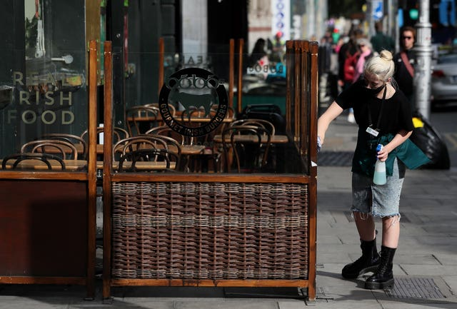 Worker cleans outside dining area at Dublin restaurant