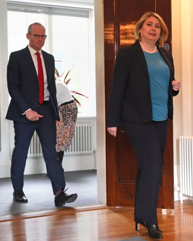 Simon Coveney and Karen Bradley arrive for a press conference at Stormont in Belfast