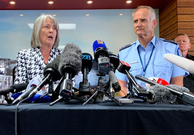 Coroner Deborah Marshall and acting assistant police commissioner Bruce Bird address a press conference in Whakatane, New Zealand (Nick Perry/AP)