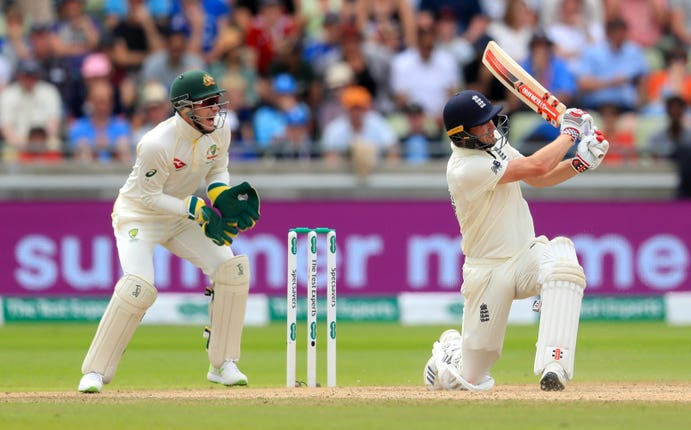 Chris Woakes, right, hits Nathan Lyon, not pictured, for six