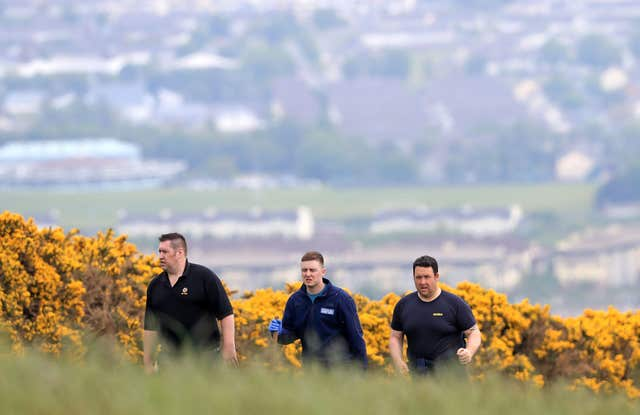 Gardai in the Puck's Castle area after a body was found in the search for missing Jastine Valdez (Donall Farmer/PA)