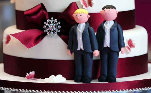 Groom cake decorations on a wedding cake