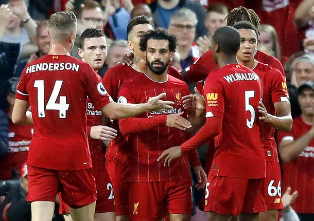 Mohamed Salah, centre, was among the goals as Liverpool began the season with a 4-1 win against Norwich