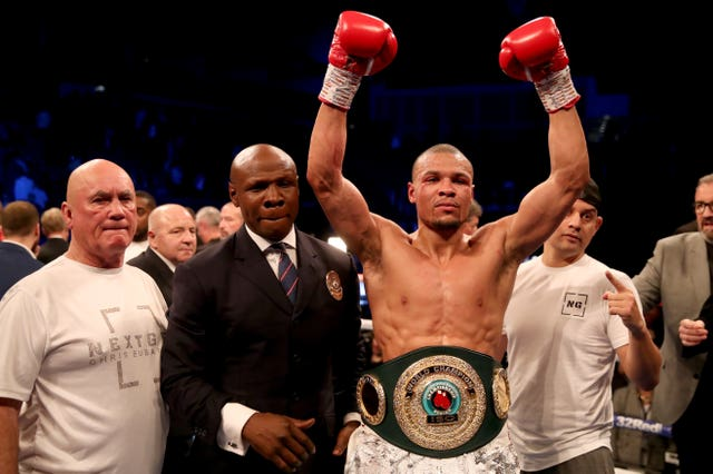 Chris Eubank Jnr celebrates after beating James DeGale in their super-middleweight match-up at London's O2 Arena