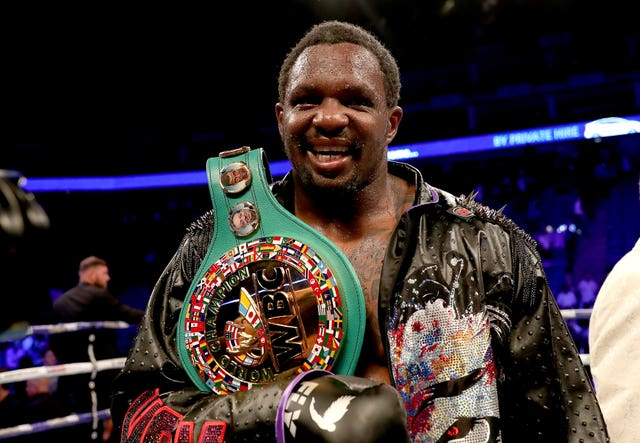 Dillian Whyte was also celebrating after defeating Oscar Rivas on points in the WBC interim heavyweight title fight in London