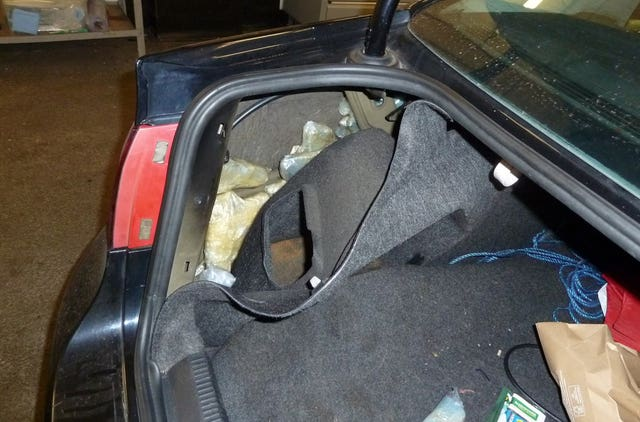 The hiding place of some of the firearms in the car