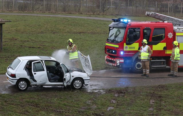Staff simulated a car fire inside the lion enclosure to test the response of animal handlers and the fire service (Andrew Milligan/PA)