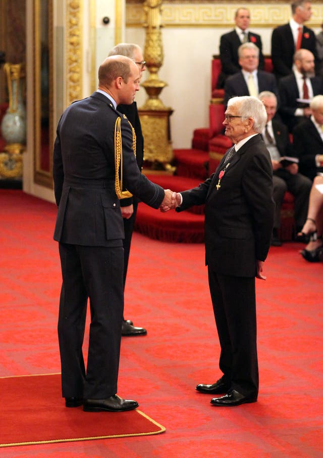 Mr Cosgrove receives his honours from the Duke of Cambridge, who told him he is a fan of his work (Jonathan Brady/PA)