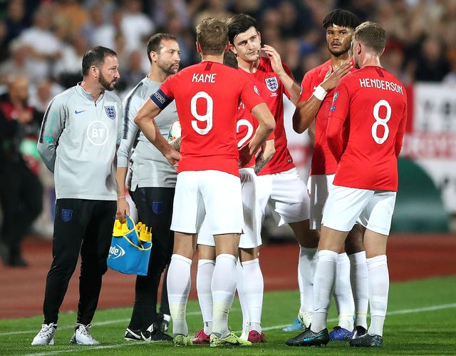 England players talk during a temporary stoppage against Bulgaria