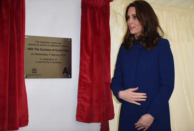 Kate unveils a plaque to officially open the centre (Eddie Mulholland/Daily Telegraph/PA)