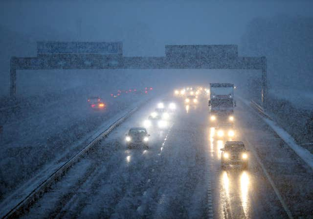 Traffic on the M9 near Falkirk during a snow blizzard in Central Scotland. (PA)