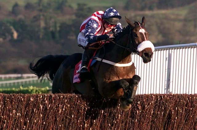 Flagship Uberalles and Richard Johnson on the way to victory in the Queen Mother Champion Chase of 2002