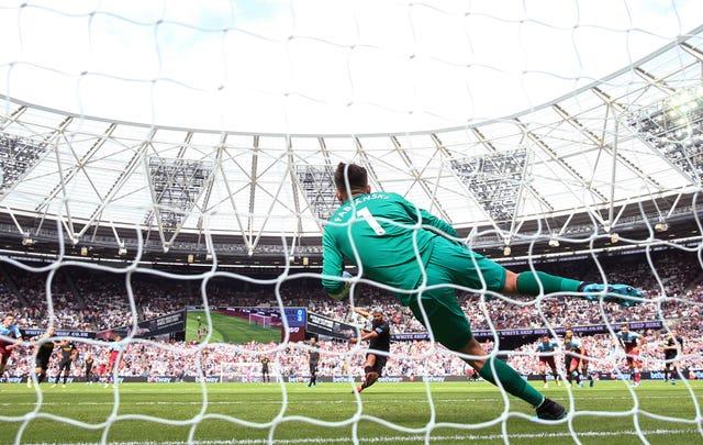 Manchester City's Sergio Aguero scores past West Ham's Lukasz Fabianski