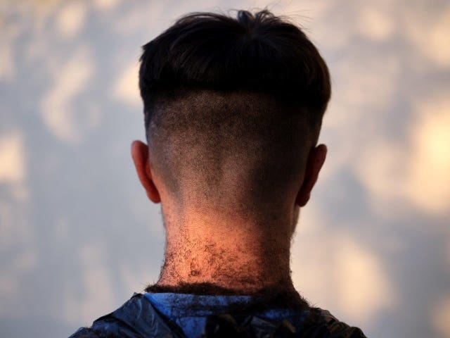A photo issued by Historic England from its Picturing Lockdown Collection of Joshua Chhabra's skin fade, a haircut given to him by his older brother Matthew, taken by commissioned artist Anand Chhabra in Wolverhampton