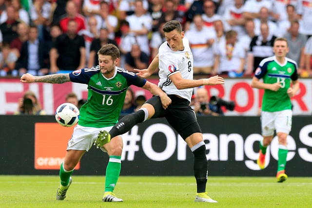 Norwood, left, played for Northern Ireland at Euro 2016