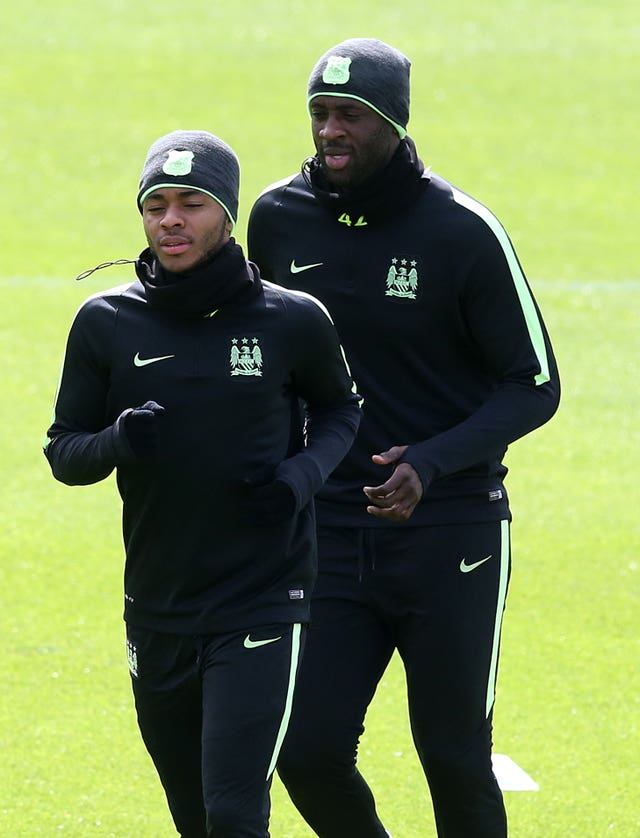 Yaya Toure (back) is fully behind Raheem Sterling (front).