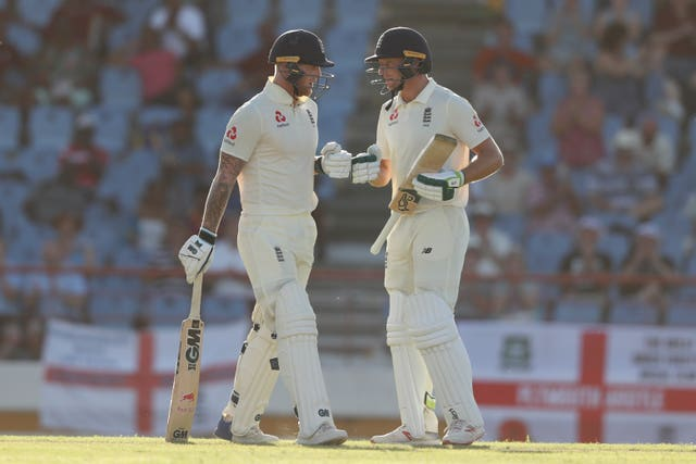 Stokes, left, celebrates his half-century with Jos Buttler