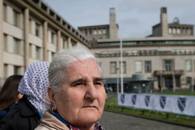 Munira Subasic, of the Mothers of Srebrenica, demonstrates outside the building which houses the International Residual Mechanism for Criminal Tribunals in The Hague, Netherlands