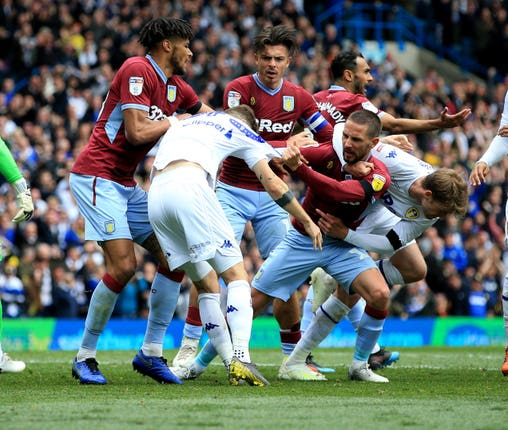 Leeds' Mateusz Klich is confronted by Aston Villa players during last season's match