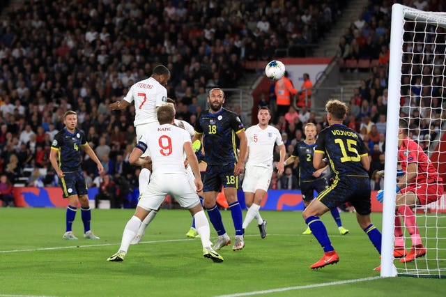 Raheem Sterling (second left) scores England's equaliser