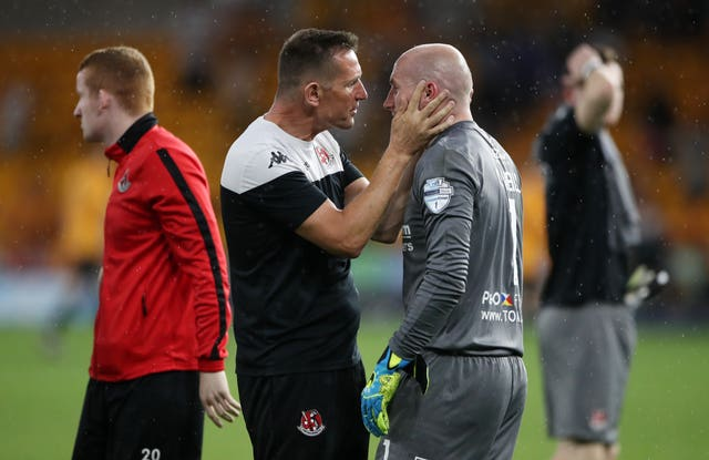 Crusaders manager Stephen Baxter consoles goalkeeper Sean O'Neill