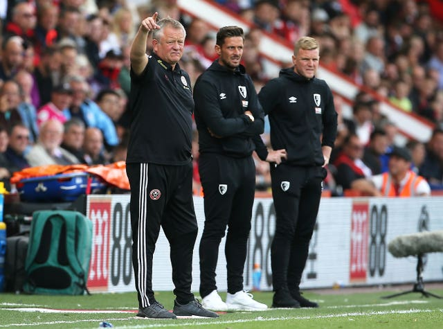 Sheffield United manager Chris Wilder, left, and Bournemouth boss Eddie Howe, right, watch on