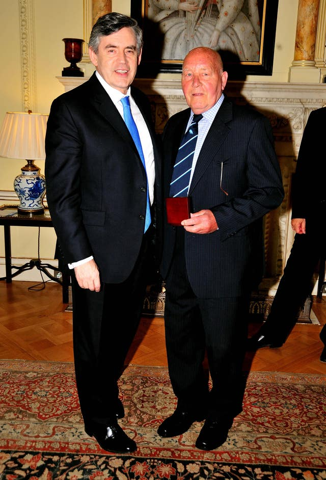 Ron Springett collects his World Cup medal from Prime Minister Gordon Brown