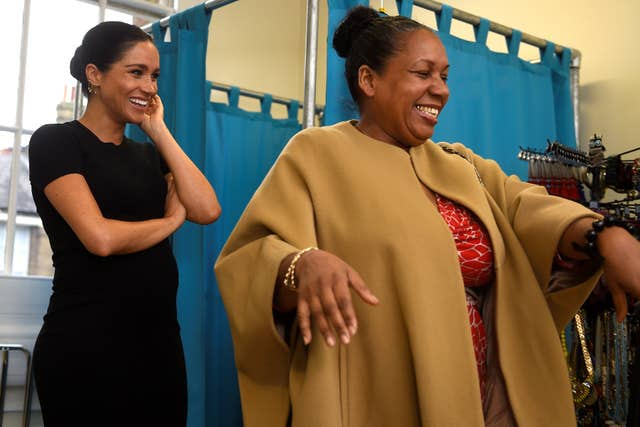 The Duchess of Sussex picks out clothes with Patsy Wardally during a visit to Smart Works in London